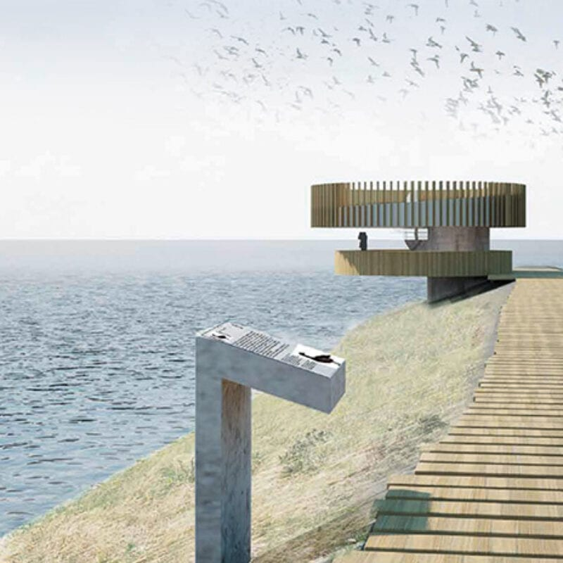 Design of the experience point at Den Oever. We look out over the water. On the land, on the right, is a kind of platform and a person is walking. There is a text sign on the platform and in the distance you can see the experience point. These are two yellow discs one above the other.