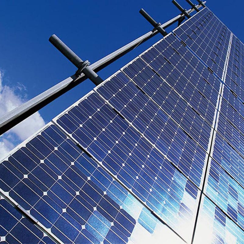 Solar panels to generate energy. Behind it you see blue sky with clouds.